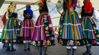 Polish dancers in colorful traditional costumes