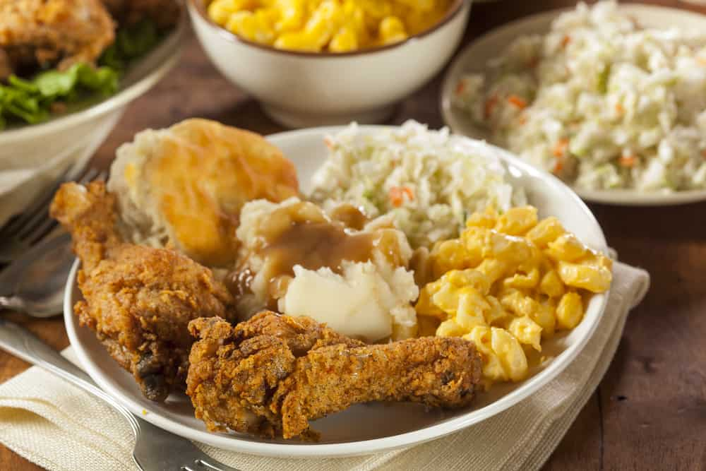 fried chicken, mashed potatoes, mac and cheese, coleslaw, and a biscuit